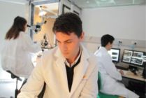 Dr Brown, Dr Chihara and a student performing an experiment